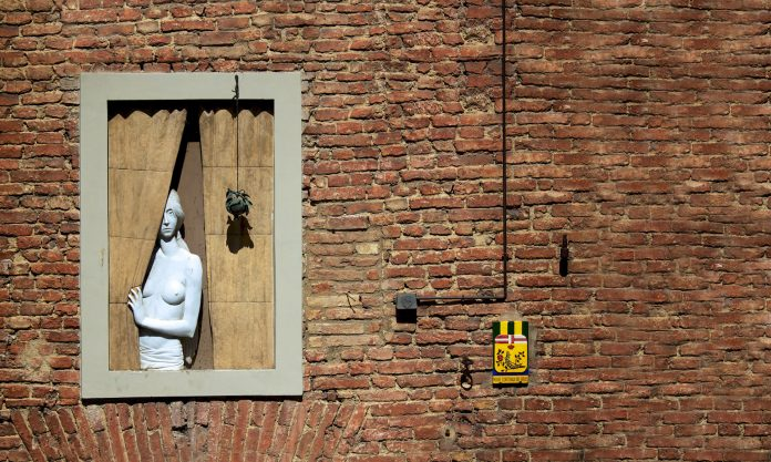 Marble woman at the window.