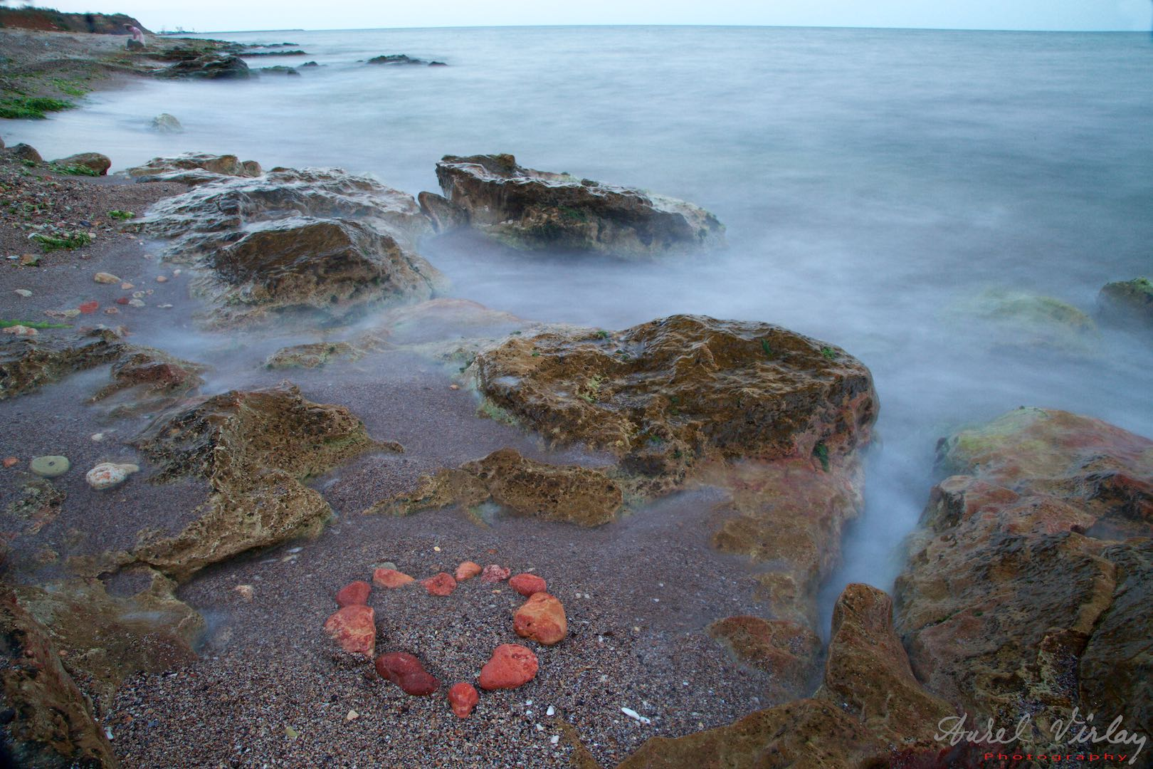 Heart of red rocks - Long time exposure photo with Black Sea waves like clouds