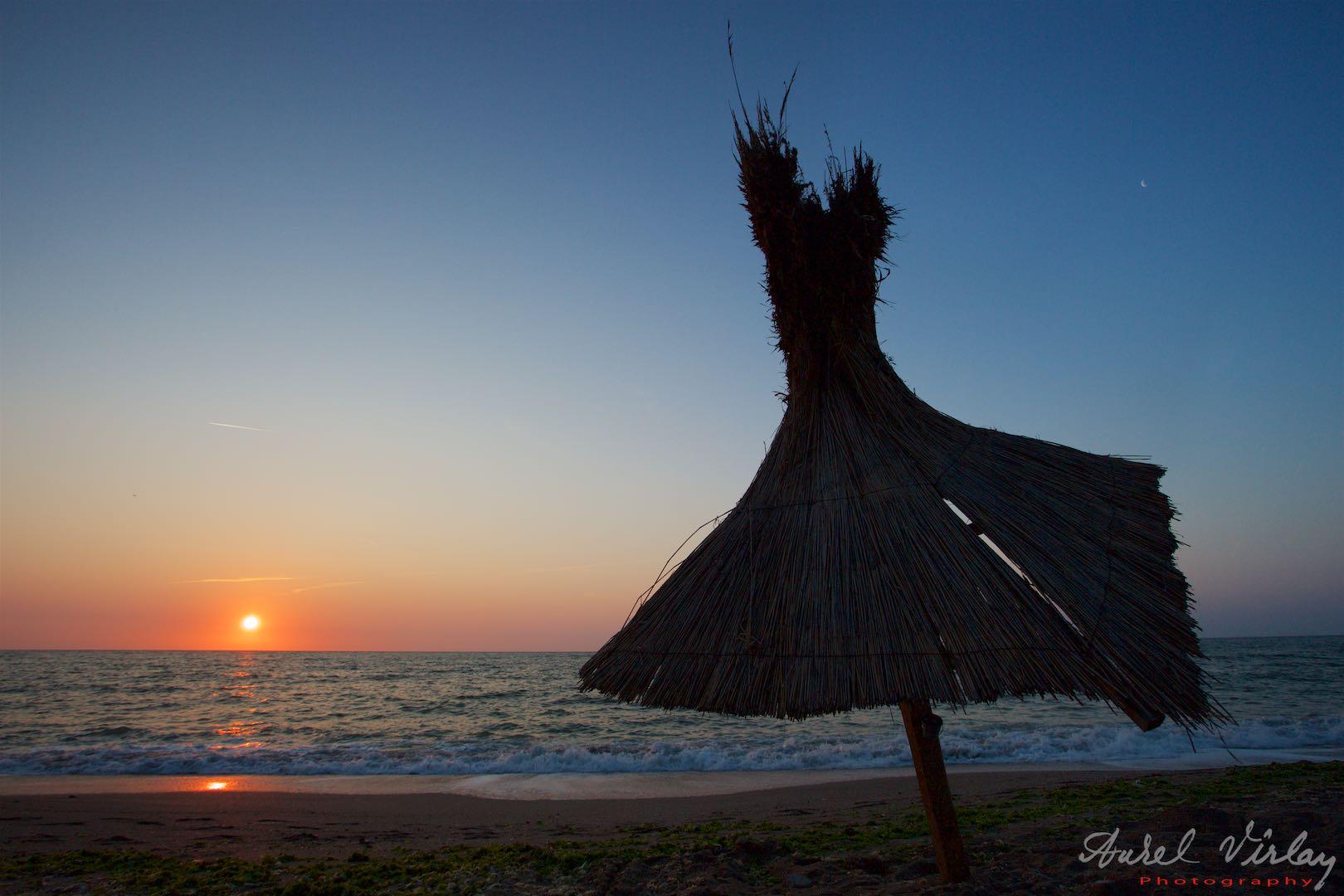 Sunrise umbrella on *Beach of Book*