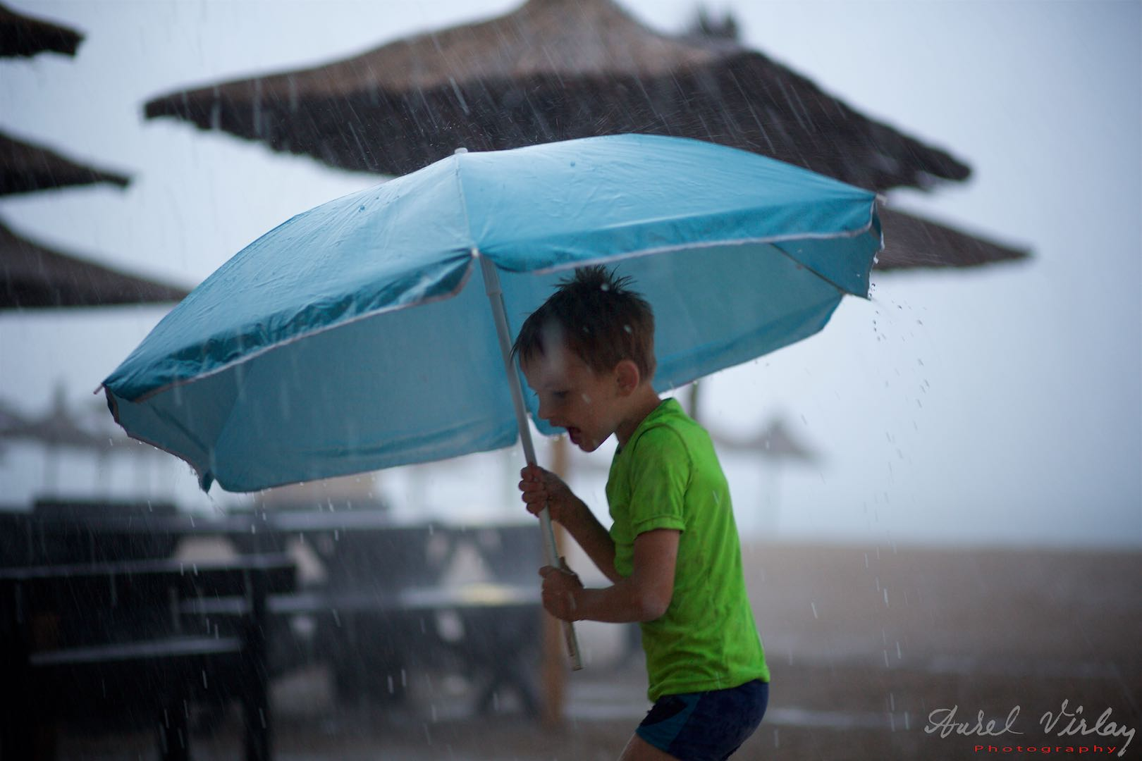 The most daring boy with a beautiful blue umbrella ... just like the photographer's soul.