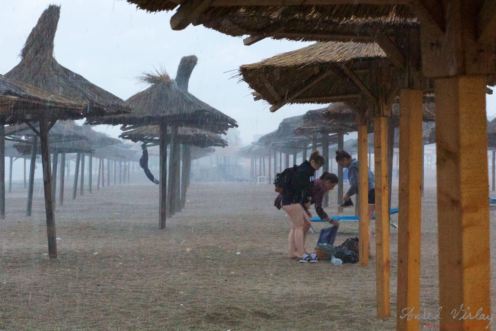 The storm has already begun! Beach umbrellas do not help much.