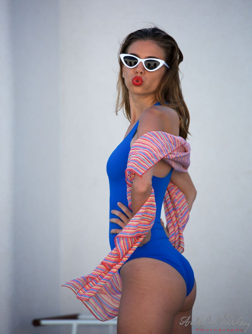 Blue swimsuit and pink scarf.